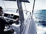 Man driving power boat Stock Photo - Premium Royalty-Free, Artist: Blend Images, Code: 614-06442928