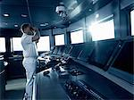 Captain in cockpit of motor yacht, using binoculars Stock Photo - Premium Royalty-Free, Artist: Aurora Photos, Code: 614-06442931