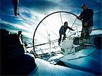 Sailors steering yacht Stock Photo - Premium Royalty-Free, Artist: Aurora Photos, Code: 614-06442938