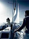 Couple on yacht with binoculars Stock Photo - Premium Royalty-Free, Artist: Ikon Images, Code: 614-06442940