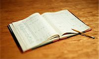 Open account book on wooden desktop Stock Photo - Premium Royalty-Freenull, Code: 614-06442943