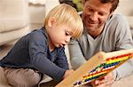 Father and son playing with abacus Stock Photo - Premium Royalty-Free, Artist: Uwe Umstätter, Code: 614-06443003