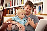 Father and son with laptop Stock Photo - Premium Royalty-Free, Artist: Aflo Relax, Code: 614-06443009