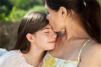 preteen kissing - Portrait of mother kissing daughter on forehead Stock Photo - Premium Royalty-Freenull, Code: 614-06443070