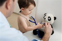 Little boy and doctor using stethoscope on panda toy Stock Photo - Premium Royalty-Freenull, Code: 614-06443111