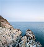 Cliff with calm sea against clear sky Stock Photo - Premium Royalty-Free, Artist: urbanlip.com, Code: 698-06443738