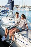 Happy young couple looking at each other while sitting on sailboat Stock Photo - Premium Royalty-Free, Artist: ableimages, Code: 698-06443742