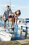 Young couple getting out from sail boat Stock Photo - Premium Royalty-Free, Artist: CulturaRM, Code: 698-06443744