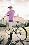 Portrait of a mid adult woman standing with bicycle using cell phone Stock Photo - Premium Royalty-Free, Artist: Ascent Xmedia, Code: 698-06443933