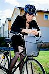Mid-adult female business commuter with bicycle using cell phone Stock Photo - Premium Royalty-Free, Artist: Ascent Xmedia, Code: 698-06443952