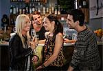 Bar tender looking at friends smiling at counter Stock Photo - Premium Royalty-Free, Artist: Blend Images, Code: 698-06443991