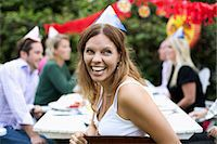Happy mid adult woman looking away while celebrating crayfish party with friends in the background Stock Photo - Premium Royalty-Freenull, Code: 698-06444020