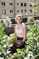Portrait of young woman sitting at urban garden Stock Photo - Premium Royalty-Freenull, Code: 698-06444208