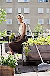 Portrait of young woman gardening Stock Photo - Premium Royalty-Free, Artist: Blend Images, Code: 698-06444209