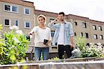 Young couple examining plants at urban garden Stock Photo - Premium Royalty-Free, Artist: Cultura RM, Code: 698-06444225