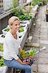 Thoughtful young woman with freshly harvested vegetables at urban garden Stock Photo - Premium Royalty-Free, Artist: Aflo Relax, Code: 698-06444233