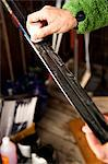 Man's hand waxing skis for cross country skiing Stock Photo - Premium Royalty-Free, Artist: Robert Harding Images, Code: 698-06444257