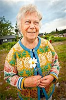 Happy senior woman standing at park looking away Stock Photo - Premium Royalty-Freenull, Code: 698-06444276