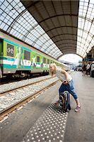 Young girl waiting for train Stock Photo - Premium Royalty-Freenull, Code: 698-06444438