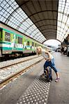Young girl waiting for train Stock Photo - Premium Royalty-Free, Artist: Blend Images, Code: 698-06444438