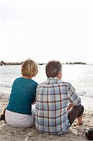 Rear view of couple looking at sea Stock Photo - Premium Royalty-Freenull, Code: 698-06444463
