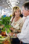 Couple holding parsley at market Stock Photo - Premium Royalty-Free, Artist: Blend Images, Code: 698-06444473