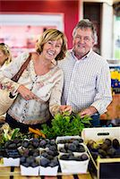Portrait of happy couple at vegetable shop Stock Photo - Premium Royalty-Freenull, Code: 698-06444474