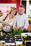 Portrait of happy couple at vegetable shop Stock Photo - Premium Royalty-Free, Artist: Photocuisine, Code: 698-06444474