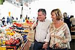 Happy couple looking at fruits in market Stock Photo - Premium Royalty-Free, Artist: GreatStock, Code: 698-06444480