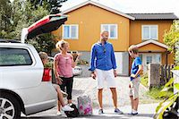 Caucasian family in discussion standing by car going for picnic Stock Photo - Premium Royalty-Freenull, Code: 698-06444500
