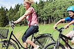 Happy mature woman and son riding bicycles during vacations Stock Photo - Premium Royalty-Freenull, Code: 698-06444504
