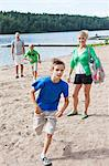 Caucasian family spending leisure time on beach Stock Photo - Premium Royalty-Free, Arti