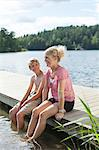 Happy mature woman sitting with son on pier during vacations Stock Photo - Premium Royalty-Free, Artist: Jason Friend, Code: 698-06444519