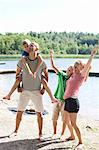Happy Caucasian family enjoying together at beach Stock Photo - Premium Royalty-Freenull, Code: 698-06444530