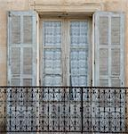 An old window, iron balcony and lace curtains in the picturesque village of Aregno in the inland Haute Balagne region, Corsica, France, Europe Stock Photo - Premium Rights-Managed, Artist: Robert Harding Images, Code: 841-06445550