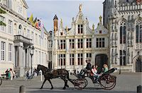 A horse drawn carriage crosses the Burg Square, passing the Stadhuis (Town Hall) buildings, Brugge, Belgium, Europe Stock Photo - Premium Rights-Managednull, Code: 841-06446256