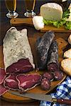 Motsetta (Motzetta) (Mocetta), chamois or beef meat salted, seasoned and dried, Boudin sausages and goat cheese, Italy, Europe