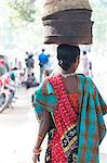 Woman at weekly tribal market wearing brightly coloured clothing and carrying baskets on her head, Bissam Cuttack, Orissa, India, Asia Stock Photo - Premium Rights-Managed, Artist: Robert Harding Images, Code: 841-06447664