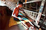 Young boy at domestic loom weaving patterned silk sari using several spools of silk, Vaidyanathpur weaving village, Orissa, India, Asia Stock Photo - Premium Rights-Managed, Artist: Robert Harding Images, Code: 841-06447676