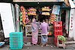 Man and woman shopping at local shop in Kumartuli district of Kolkata, West Bengal, India, Asia Stock Photo - Premium Rights-Managed, Artist: Robert Harding Images, Code: 841-06447742