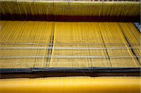 silky - Yellow dyed silk being woven on loom, Naupatana weaving village, rural Orissa, India, Asia Stock Photo - Premium Rights-Managednull, Code: 841-06447815