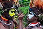 Tribesmen puting colour on their faces to celebrate the traditional Sing Sing in Paya in the Highlands, Papua New Guinea, Pacific Stock Photo - Premium Rights-Managed, Artist: Robert Harding Images, Code: 841-06448222