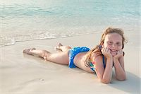 Girl lying in sand at Grace Bay beach, Providenciales, Turks and Caicos Islands, West Indies, Caribbean, Central America Stock Photo - Premium Rights-Managednull, Code: 841-06448698