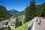 View over town and cyclists, Canazei, Val di Fassa, Trentino-Alto Adige, Italy, Europe Stock Photo - Premium Rights-Managed, Artist: Robert Harding Images, Code: 841-06448749