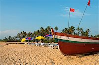 Traditional fishing boat and sunbathers on beach, Benaulim, Goa, India, Asia Stock Photo - Premium Rights-Managednull, Code: 841-06449368