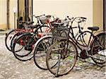 parked bicycles on cobblestone street, Tuscany, Italy Stock Photo - Premium Rights-Managed, Artist: Michael Mahovlich, Code: 700-06452092