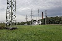 House in Field Beneath High Voltage Power Lines, Charleroi, Wallonia, Belgium Stock Photo - Premium Rights-Managednull, Code: 700-06452137