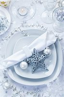 Place setting in white and silver for Christmas with star Stock Photo - Royalty-Freenull, Code: 400-06457282