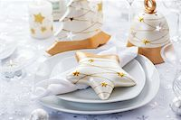 Festive table for Christmas in white and golden tones Stock Photo - Royalty-Freenull, Code: 400-06457283