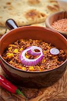 Mexican chilli con carne with red lentils and flatbread Stock Photo - Royalty-Freenull, Code: 400-06457296